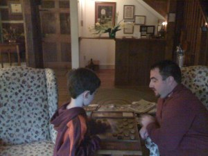 Playing checkers in the main building by the fire